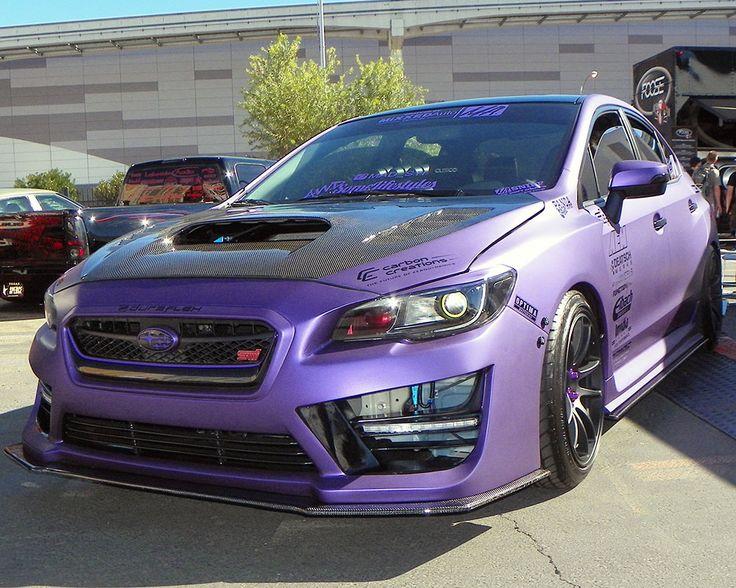 2015 Subaru WRX STi shown here in a special purple vinyl wrap attended the 2014 SEMA Show