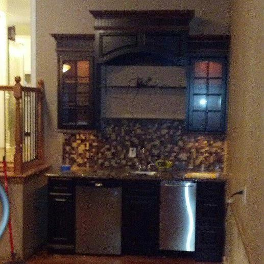 Wet bar built in a small space in a man cave includes a - Bars for small spaces ...
