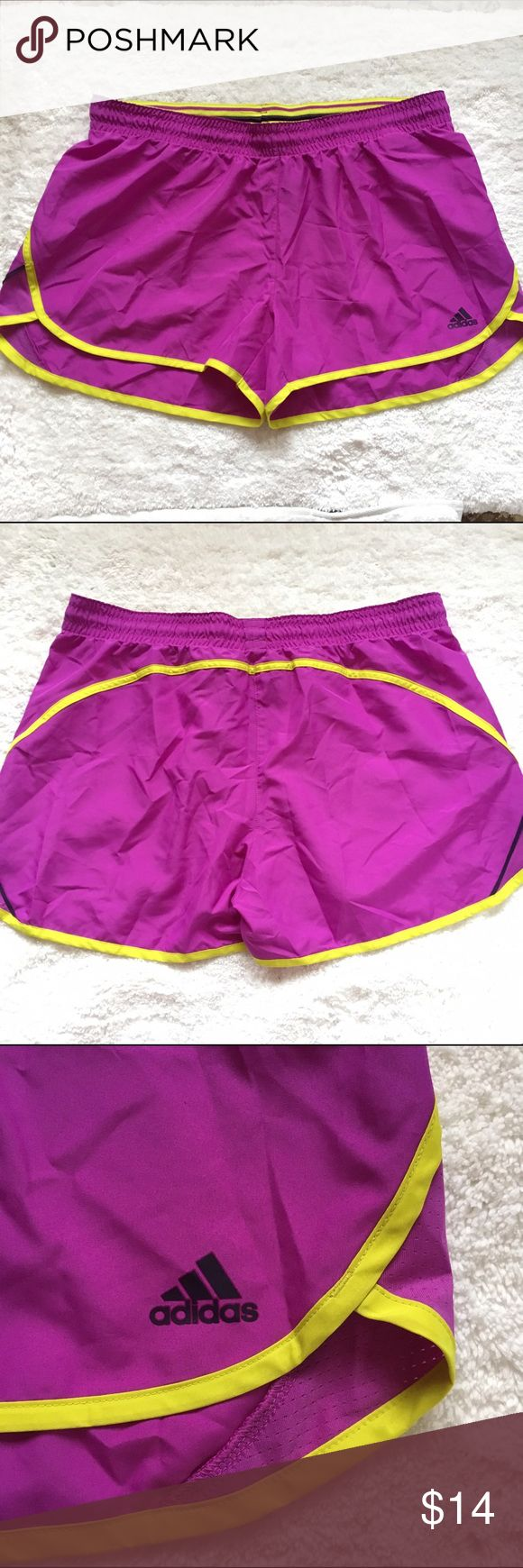 NWOT Adidas purple workout shorts sz L Adidas Workout shorts womens size large. With adjustable drawstring waist. The style is climalite performance fitness blitz short. Purple and yellow. They are 100% polyester. The shorts are NEW without tags. Adidas Shorts