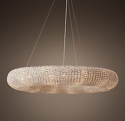 """RH's Crystal Halo Chandelier 41"""":Inspired by a stunning antique French chandelier from the 1930s, ours echoes the ingenuity of those designs. Over 44,000 faceted, hand-wrapped crystal glass beads wrap the steel frame to form a floating orb, suspended via a steel cable. The beadwork, reflecting and refracting the interior light, casts a warm glow.SHOP THE ENTIRE COLLECTION ▸"""