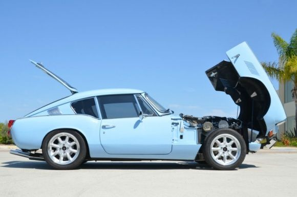 his 1969 Triumph GT6 was recently rebuilt by the seller who gives a very detailed report of his thorough and impressive build of the car. It started green, but we love this pale blue color, the same as on the TR4 we featured earlier this week. Deleted bumpers and an adjustable GAZ suspension dropped down over 15″ VTO wheels has the thing looking just about perfect. Find it here on eBay in San Diego, California.