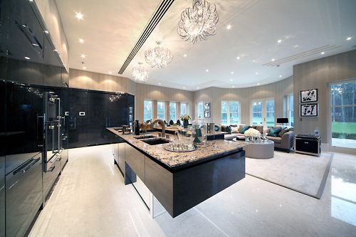 Love the dark colors with the light granite in this kitchen