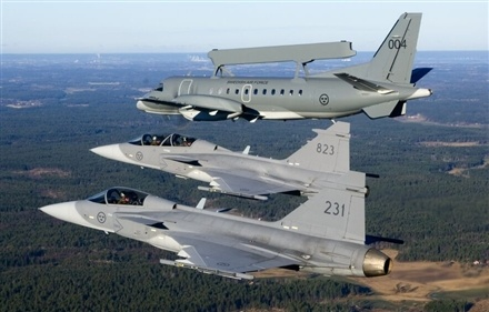 Swedish air force Gripens accompanied by a Saab 340 Erieye airborne early warning & control aircraft