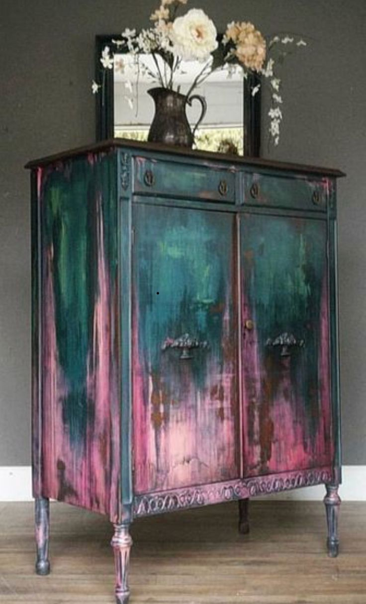 teal and pink antique cabinet