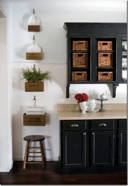 kitchens - black kitchen cabinets wicker baskets white wainscoting wall wood boxes stool kitchen Painted black kitchen cabinets, wicker baskets,