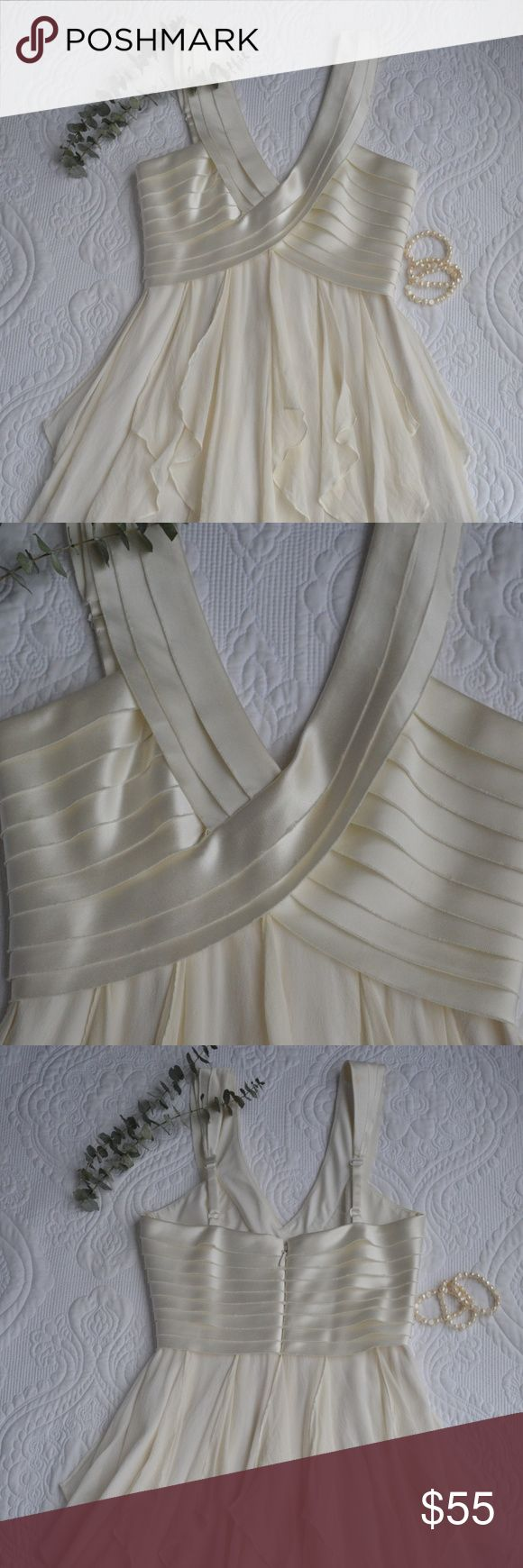 BCBGMAXAZRIA Shutter Pleat Dress Off white. Light airy dress with shutter-pleated bodice and tiered skirt layered with chiffon. Satin bodice has unfinished edges look. Silk layer beneath chiffon, peaks out from beneath the chiffon layers see picture 5. Picture 8  is for fit reference only. Smoke free home. 10% bundle discount. Offers considered. Please ask questions!! BCBGMaxAzria Dresses Mini