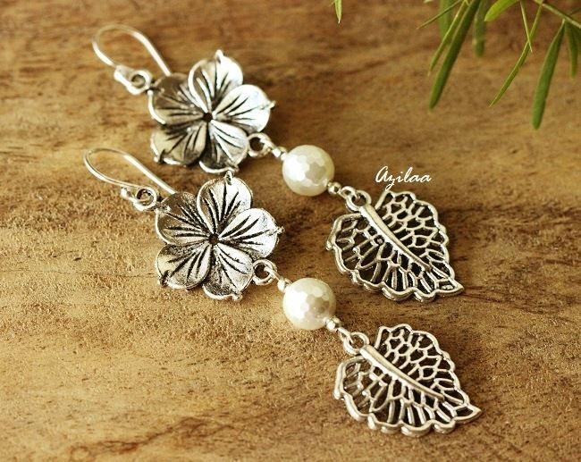 Modern flower pearl charm silver dangler leaf earrings $999.00