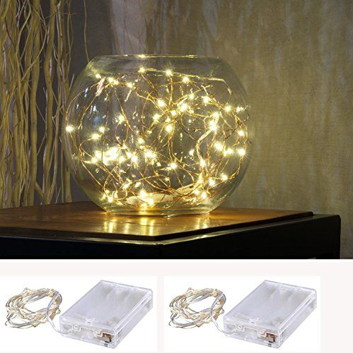 """Pack of 2 sets LED SopoTek 7ft 20 LEDS Starry Lights Fairy Lights Copper LED Lights Strings AA Battery Powered Ultra Thin String Wire(Battery not included) - About US: LED SopoTek is a manufacture specially in led products, So search """"LED SopoTek""""You will find latest designs and best price in higher quality. Surprise and best exprience begin with LED SopoTek! 2 Sets LED SopoTek 7ft 20 LEDS Warm white Starry Lights Fairy Lights Copper wire LED L..."""