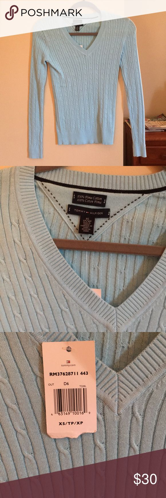 Tommy Hilfiger NWT light blue sweater NWT v-neck Tommy Hilfiger cable knit sweater. Beautiful light blue color. 100% prima cotton. Would make an excellent Christmas gift! Tommy Hilfiger Sweaters V-Necks