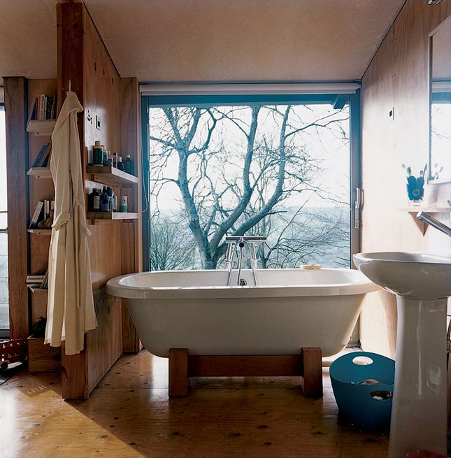 In the master bathroom upstairs, the Tokyo roll-top bathtub from victoriaplumb benefits from an epic view.  Photo by: Ben Anders