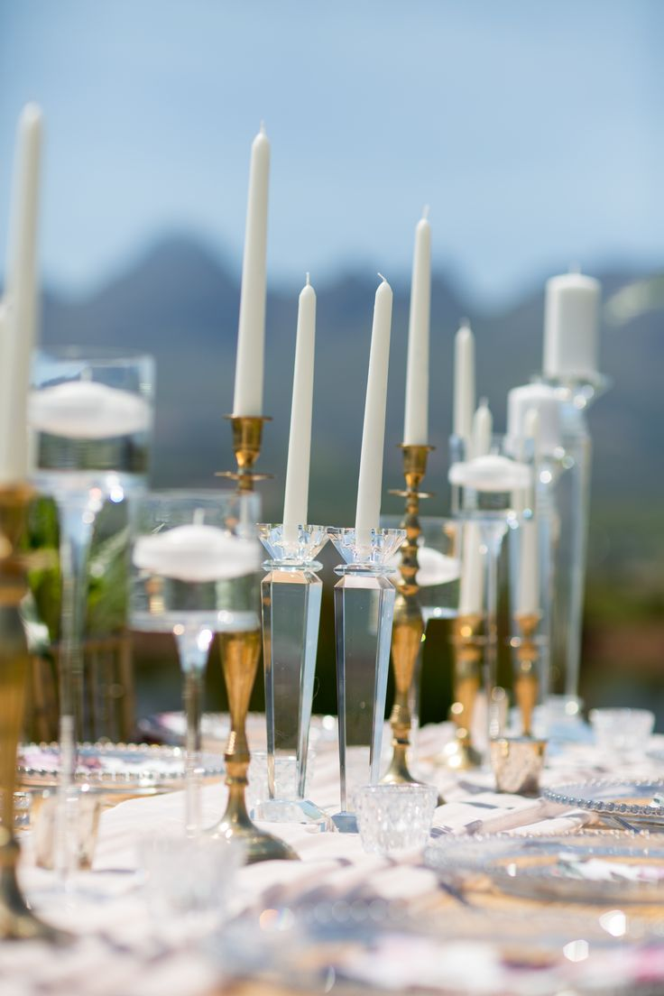 Glass, crystal and gold candle holders and sticks