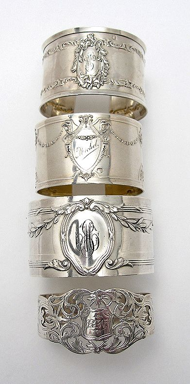 These are Antique silver napkin rings but great idea for vintage silverware to cut off utensil end and bend for one of a kind vintage napkin rings