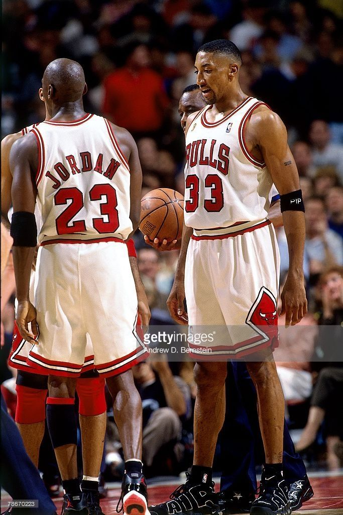 Michael Jordan  23 and Scottie Pippen  33 of the Chicago Bulls discuss  strategy against the Seattle SuperSonics during Game Two of the 1996 NBA  Finals at ... 18781a7f4