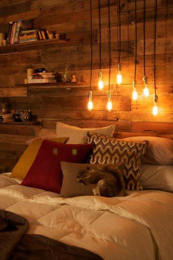The pallet wall background gives your room a rustic and vintage look. You can light up some small bulbs in the room to create more effect.