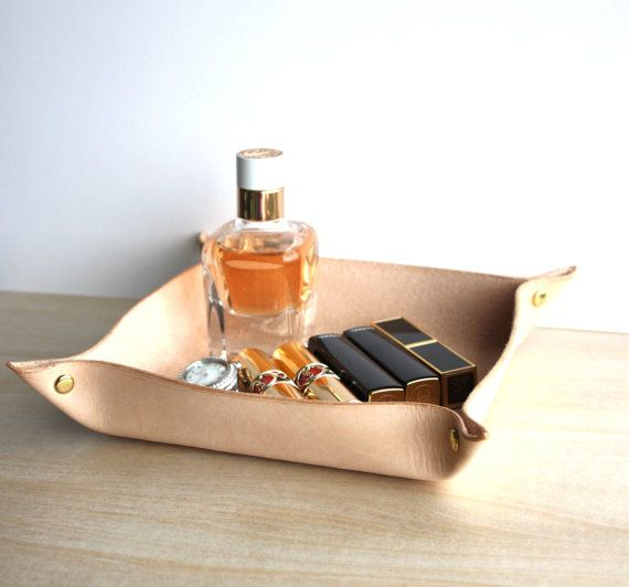 ooh, this could be a real unisex treasure, handmade leather valet tray or small trinket holder, that can be personalised. Maybe get a His and a Hers while you're at it? Personalised Leather Valet Tray / by TheLeatherCollective on Etsy