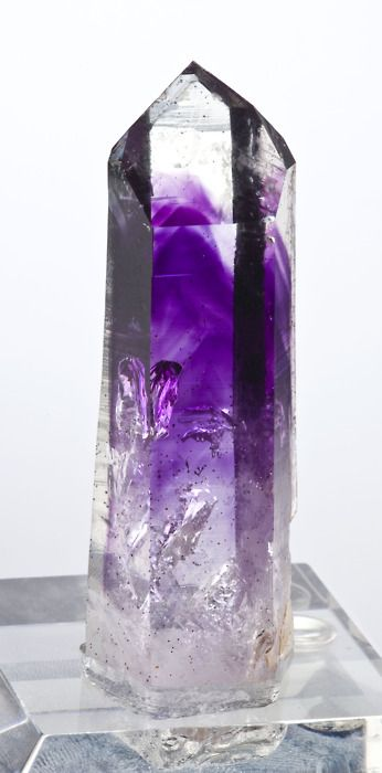 Amethyst included in Quartz from Namibia        morbidfascinationofdeath reblogged this from mineralia
