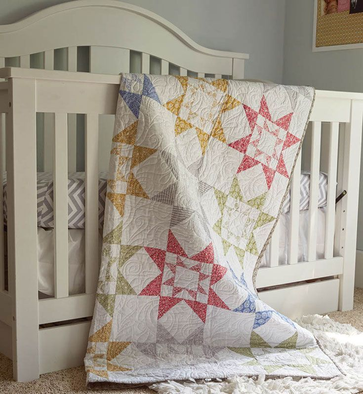 Like the popular Japanese puzzle, these star quilt blocks are based on a square grid layout. A  Scandinavian-inspired fabric collection was used to construct the Star-in-a-Star quilt blocks and Flying Geese units, in two sizes, make quick work of piecing.