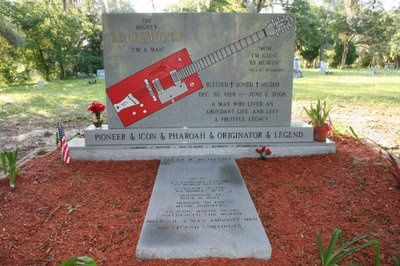 """Grave Marker- Bo Diddley, American musician. His funeral, a four-hour """"homegoing"""" service, took place on June 7, 2008, at Showers of Blessings Church in Gainesville, Florida and kept in tune with the vibrant spirit of Bo Diddley's life and career. The many in attendance chanted """"Hey Bo Diddley"""" as a gospel band played the legend's music. A number of notable musicians sent flowers, including: George Thorogood, Tom Petty, and Jerry Lee Lewis."""