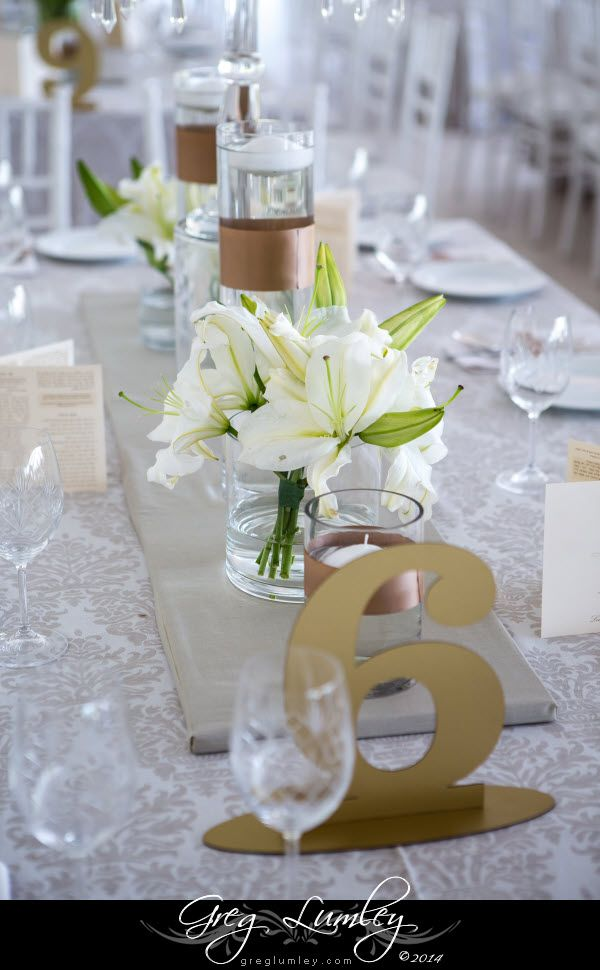 Gold and White Table decor for wedding at Lourensford Wine Estate.