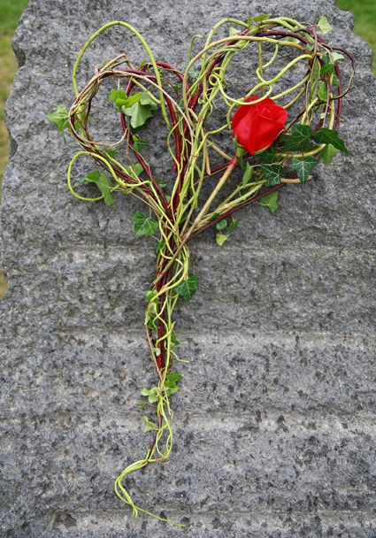 Heart of twigs and a red rose - All Saints Day - to commemorate the dead. - Interflora flowers