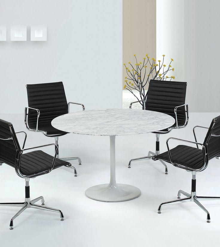 Meeting space in the office with smooth marble table finish and black replica designer chairs. #office #commercial #furniture