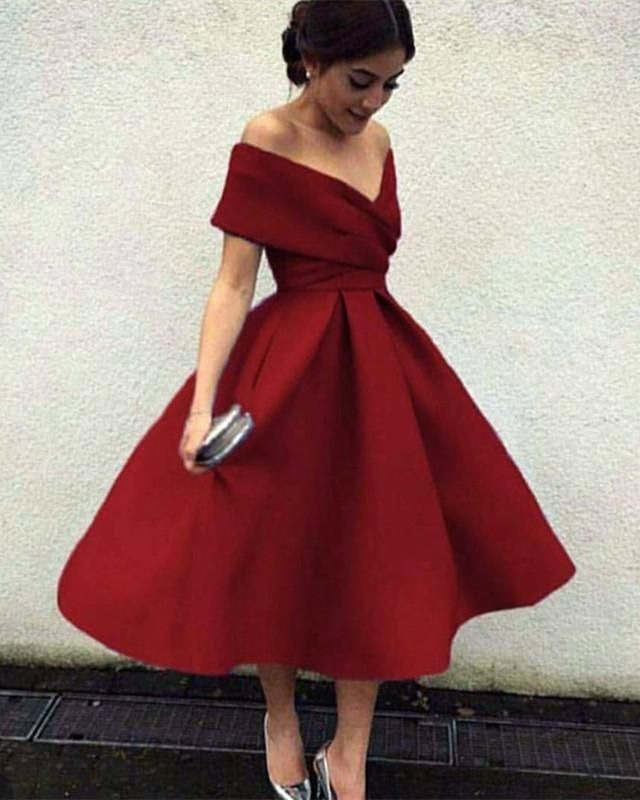 b3b7afc217 Item Description   A Vintage Looking Tea Length Satin Dress With V-neck And  Off The Shoulder Neckline.Puffy Skirts with Zipper Back design