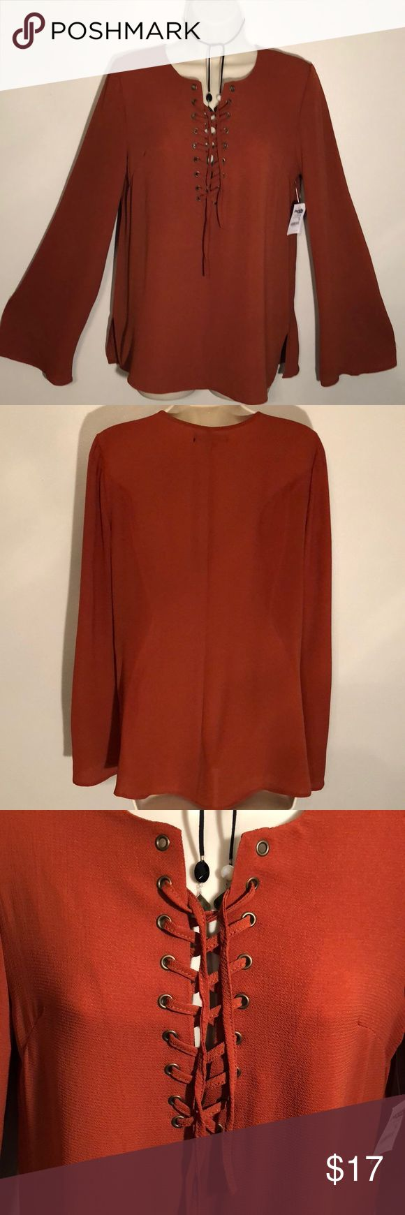 🆕 CHARLOTTE RUSSE MEDIUM PUMPKIN TUNIC TOP Charlotte Russe Pumpkin Tunic➖Size Medium➖Lace Tied Top➖Bell Sleeves➖Creped Polyester➖Great with Jeans or Leggings!!➖Necklace not included but available for sale in my closet 😊 Charlotte Russe Tops Tunics