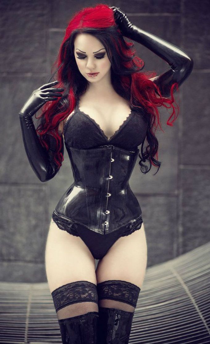 Sexy red head with black gothic underbust corset