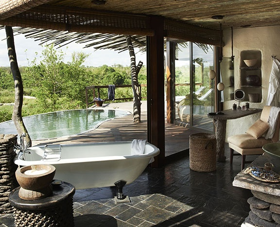 Singita Boulders Lodge offers you luxuriant nature on the doorstep of the Sabi Sand wildlife reserve, which is one of the finest in all of South Africa. Its twelve sumptuous, authentic and refined suites offer stunning views of the banks of the river Sand. Each boasts its own pool and private terrace, guaranteeing you total harmony with nature. #relaischateaux #southafrica