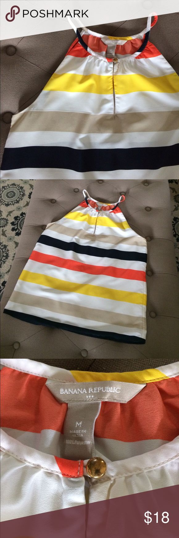 Banana Republic Tank Silky soft halter-cut tank in orange, yellow, navy, white and khaki stripes. Keyhole neckline with shiny gold button. Has two spots as seen in pics. The second is on the inside when wearing so not noticeable and the first is tiny and probably only bothers me because I'm OCD like that. 🤦♀️ Otherwise in EUC. Banana Republic Tops Tank Tops