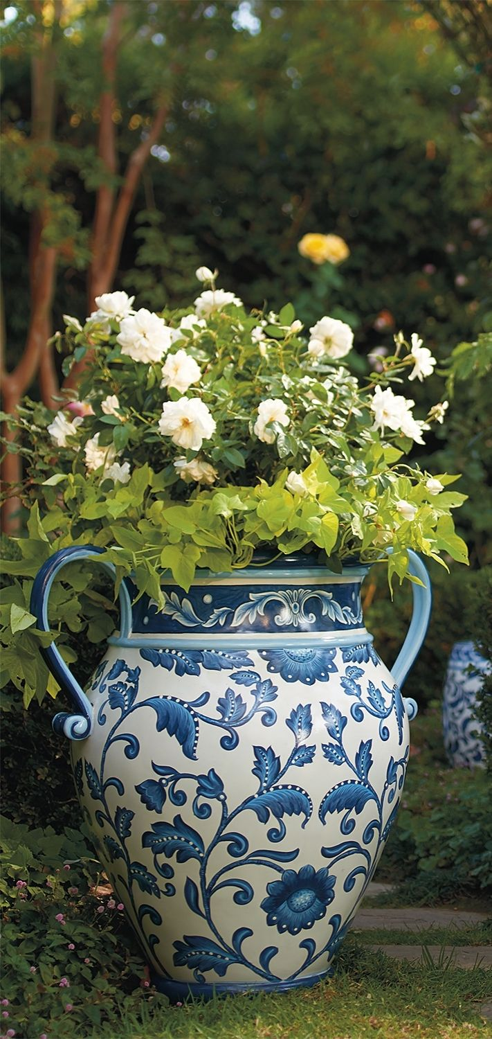 The big list of self watering planters for stylish gardening anywhere - Our Blue And White Painted Tabletop Planter Is An Indulgence In Ornate Foliage Exotic Birds And Ceramic Tile Designed Artistry