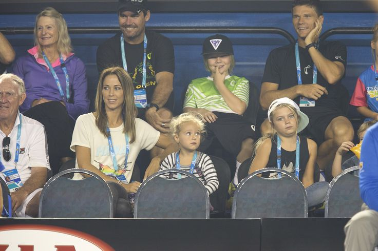 Bec Hewitt sits with daughters Ava and Mia during Kids Tennis Day in Rod Laver Arena on 17 January 2015