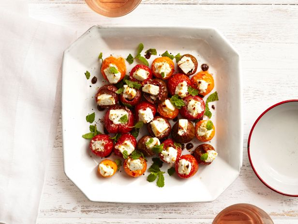 This combines two of my favorite foods, feta and cherry tomatoes. Simply stuff a cub of feta into a cherry tomatoes and put in the broiler for about 10 minutes.
