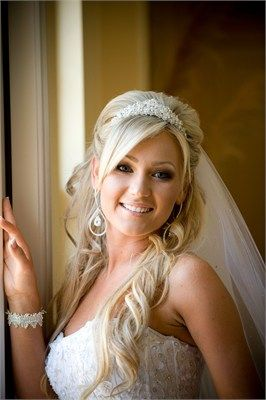 If you have long hair then wearing it down with simple curls and a fantastic tiara will make your wedding hair look simply gorgeous on the big day. Accessorise with simple jewellery and elegant make-up.