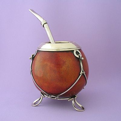Traditional mate gourd and bombilla straw filter to drink yerba mate tea.   Natural gourd with decorated rim and base totally handmade in Alpaca (German silver) by skilled artisans from Argentina.