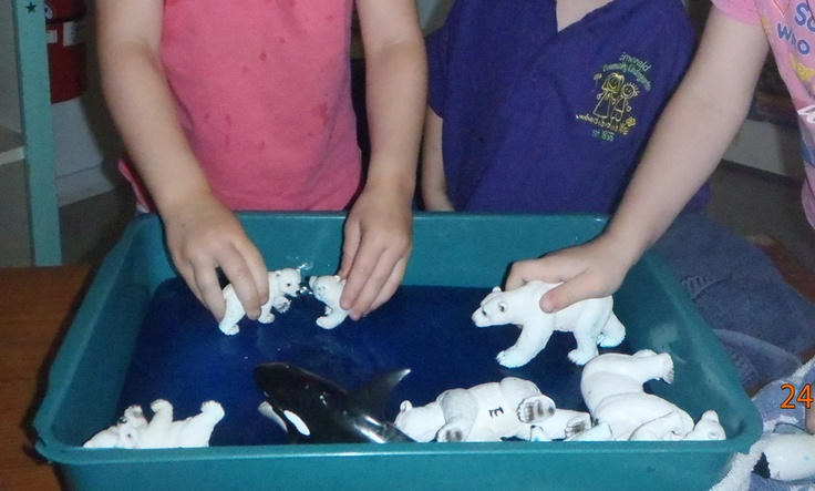 Frozen coloured water and arctic animals for imaginary & sensory play