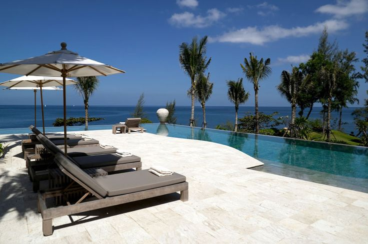 What a view! This luxury infinity pool overlooking the ocean has tropical paradise written all over it   Stone decking by Coral Stone USA http://www.poolspaoutdoor.com/buyers-guide/decks-hardscaping/coral-stone.aspx?edgpid=3967edgmid=15610#!prettyPhoto_M15610/id3967/
