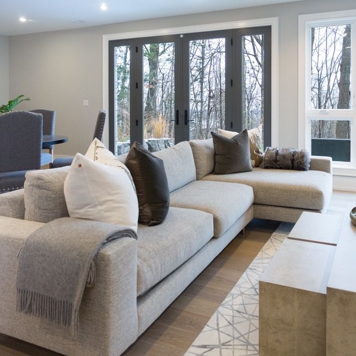 #Highview house family room from #BryanInc seen on #HGTVCanada. Furniture from Cocoon: #Minnie sectional sofa, #Tranquility nesting cocktail tables, pillows, throw and carpet. #bryanbaeumler #sarahbaeumler
