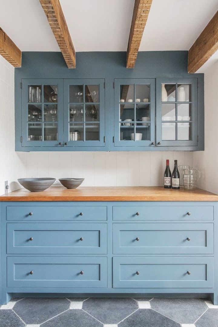 13 New Kitchen Trends - light blue cabinets, butcher block countertop, exposed beams, glass front cabinets