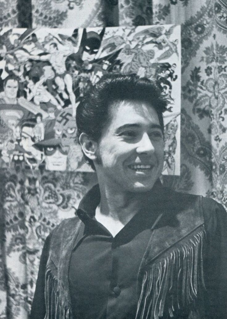 Jim Steranko looking hip in 1970 next to a mural of his art.