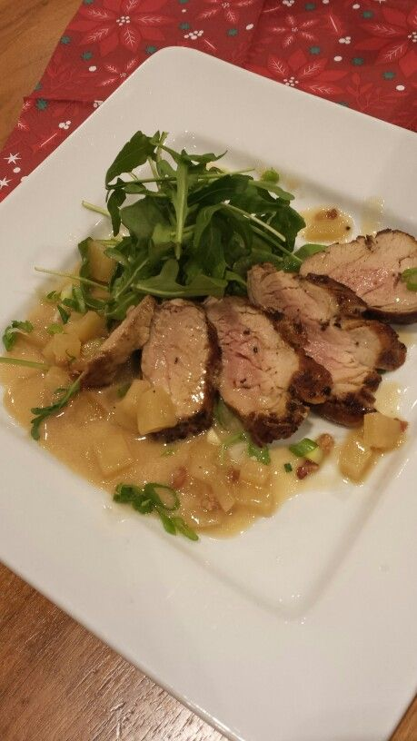 Grilled marinated Pork tenderloin with apple beer sauce, green onion and arugula salad