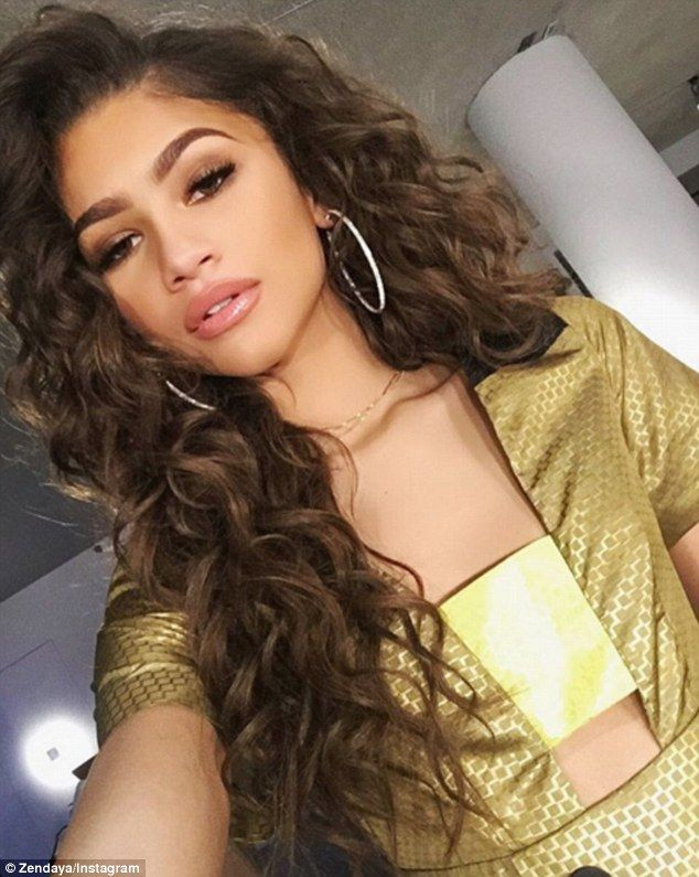 Curls for the girls: Zendaya stepped out rocking a fresh new wavy weave and looked incredible in a metallic dress as she got made up. She sent Snapchat into overdrive after revealing her basketball shorts underneath