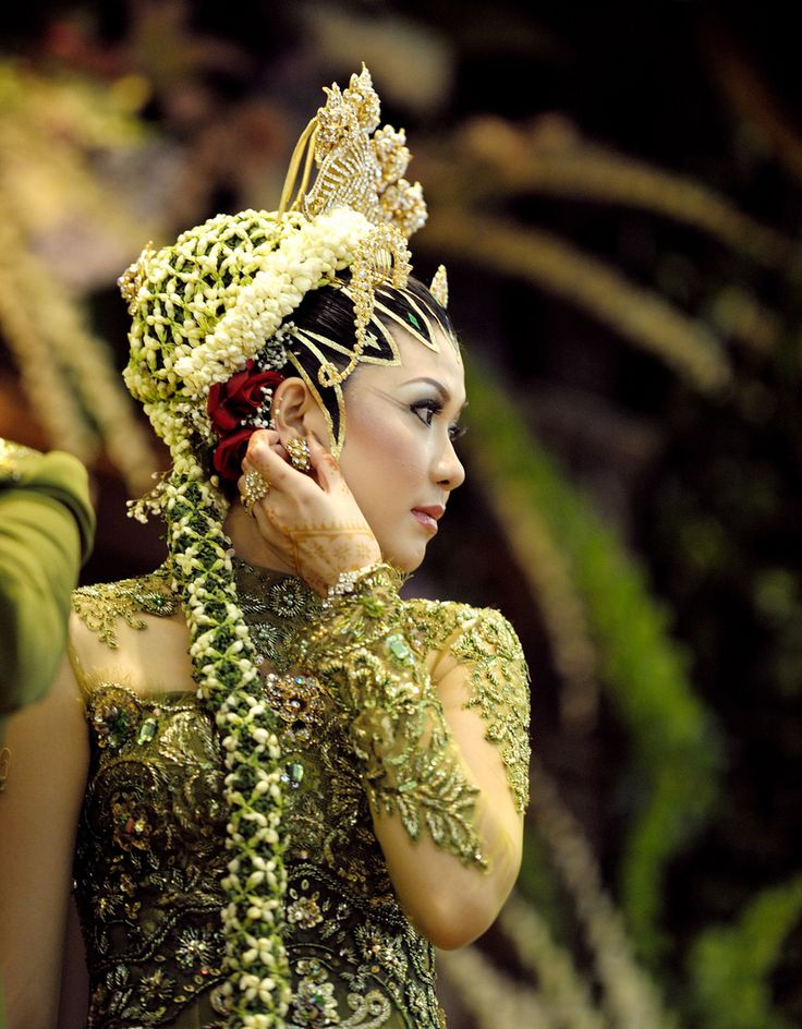 The bride by Alfonso T  A woman in traditional Javanese (Indonesia) bride costume.