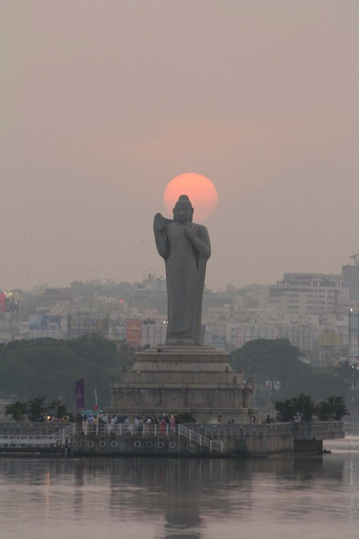 Statue of Gautama Buddha at sunset. Hussain Sagar, Hyderabad, Andhra Pradesh, India. Photography by Prime Jyothi