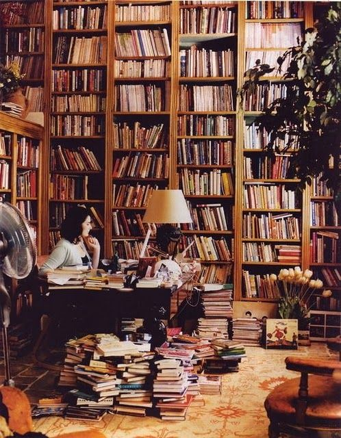 Nigella Lawson and her books. I have always dreamed of owning floor-to-ceiling shelves filled with these. <3