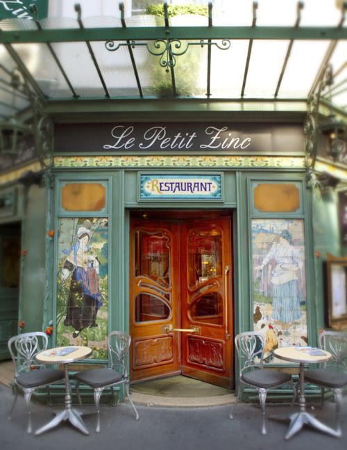 This lovely french cafe looks so cozy! I could sit there for hours with a latte and a good book. // LOVE THE DOOR!
