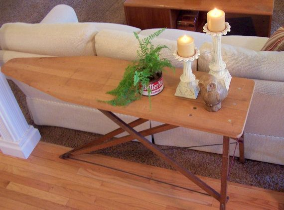 This vintage wood ironing board is the perfect size to use as a sofa table but, Ive seen them used in all sorts of ways. Use them to display plants, Christmas decor or even as a mini buffet for family get togethers.    I particularly like this one because of the rusty red x bars across the back. They add just the perfect pop of color to this otherwise neutral toned board. As a matter of fact, Id keep this myself but I already have one!    Approx. Dimensions 32 height - 54 length - 15 width…