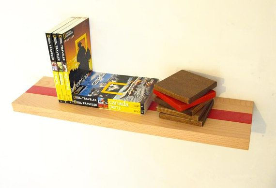 Wall shelf handmade out of solid birch, fits perfectly in any room. This shelf is best for the small yet priceless ones that you want to showcase. The red stained stripe give it a unique look. The shelf can be installed normal or upside down, depending on preferences.Size: 6 cm high x 60 cm long x 15 cm deep (2 3/8 in x 23 1/2 in x 6 in). Thickness: 2.8 cm (1 1/8 in) The wooden shelf pictured here is stained and finished using clear acrylic varnish with a matte satin look.