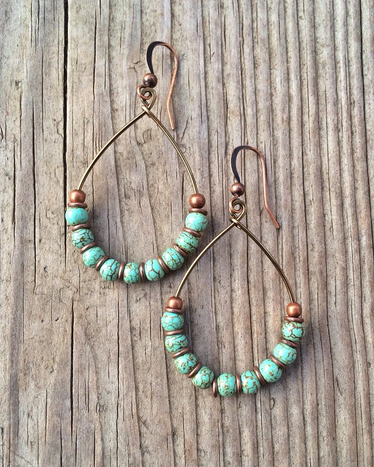 """Copper hoop earrings with turquoise. Light weight, antiqued copper hoops with small turquoise stones and copper accents. Approx 2"""" in length."""