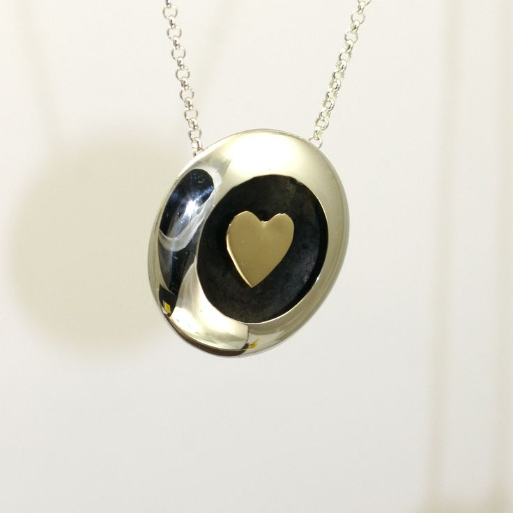Floating heart gold and silver